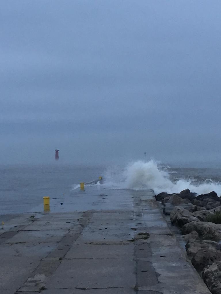 Wave crashing against shoreline
