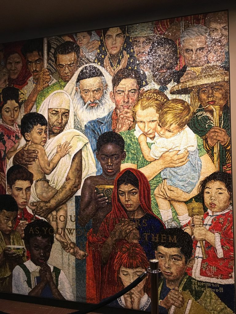 "Mosaic at the UN headquarters that states ""Do unto others as you would have them do unto you"""